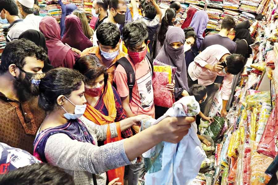 With Eid drawing nearer, shoppers throng markets in the city to buy dresses for their near and dear ones. The photo was taken at Gausia Market in the city on Saturday —FE Photo