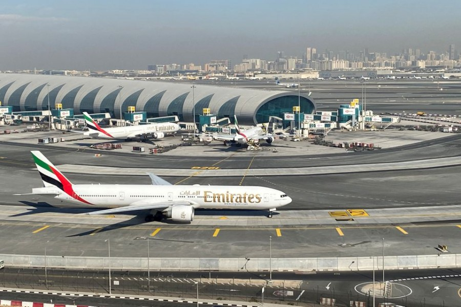 Emirates airliners are seen on the tarmac in a general view of Dubai International Airport in Dubai, United Arab Emirates January 13, 2021. Picture taken through a window. REUTERS/Abdel Hadi Ramahi