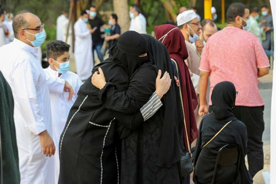 Saudi women greet each other after performing Eid prayers on the first day of Eid-ul-Fitr, amid the coronavirus disease (COVID-19) pandemic, outside the King Abdulaziz Mosque, in Riyadh, Saudi Arabia, May 13, 2021. REUTERS