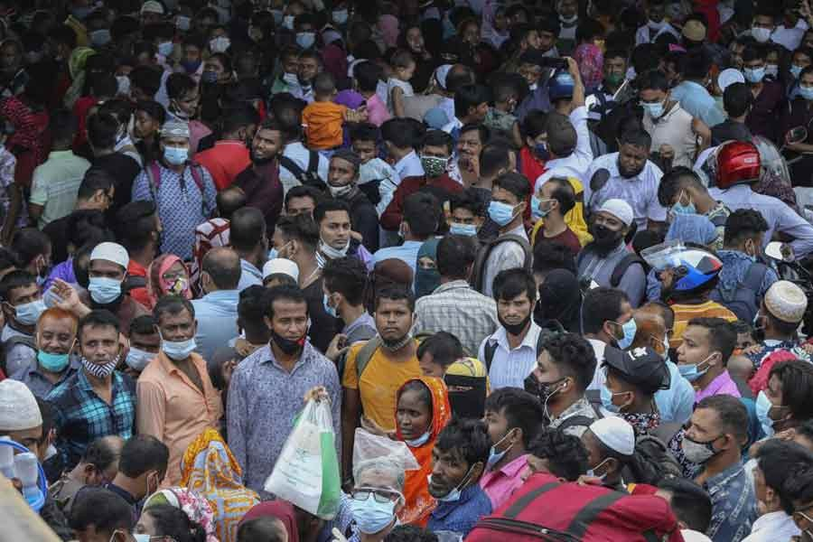 Thousands of people leaving for their native places to celebrate Eid-al-Fitr throng the Mawa ferry terminal in Munshiganj on Thursday ignoring risks of coronavirus infection –AP Photo