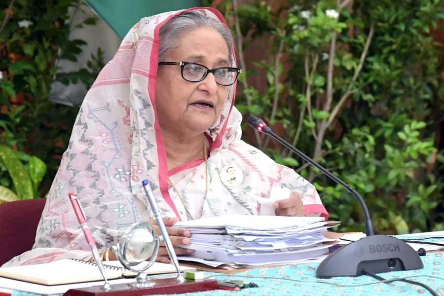 Prime Minister Sheikh Hasina presiding over a weekly cabinet meeting virtually from Ganabhaban on Monday –PID Photo