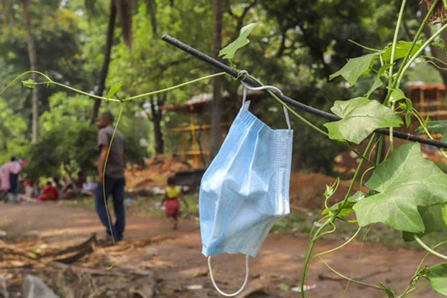 A mask discarded by some passerby is tangled among some vines at Dhaka's Suhrawardy Udyan recently –bdnews24.com file photo