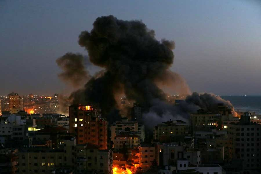 Smoke rising from a building after it was destroyed by Israeli air strikes amid a flare-up of Israeli-Palestinian violence in Gaza on May 11 –Reuters file photo