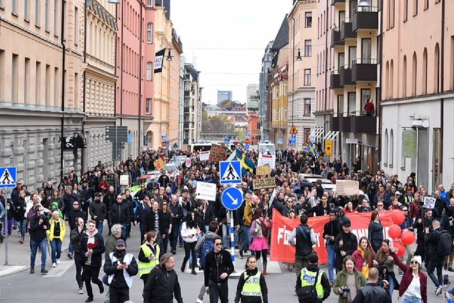 Protesters from Frihet Sverige (Freedom Sweden) march to protest against coronavirus disease (COVID-19) restrictions, in Stockholm, Sweden May 1, 2021. REUTERS