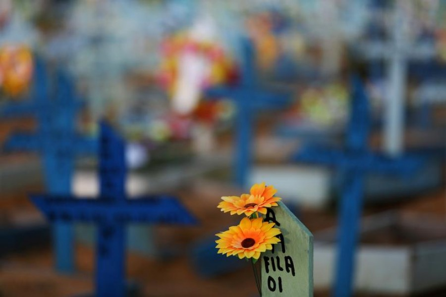 Flowers are seen on the grave of a person who passed away due to the coronavirus disease (Covid-19) at the Parque Taruma cemetery in Manaus, Brazil on May 20, 2021 — Reuters photo