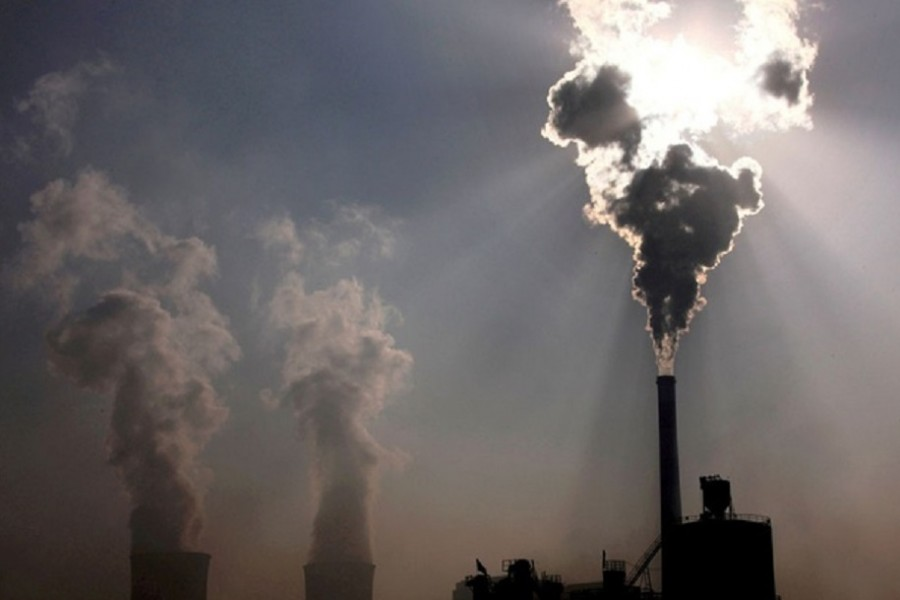 A coal-burning power plant can be seen behind a factory in China's Inner Mongolia Autonomous Region, October 31, 2010. REUTERS