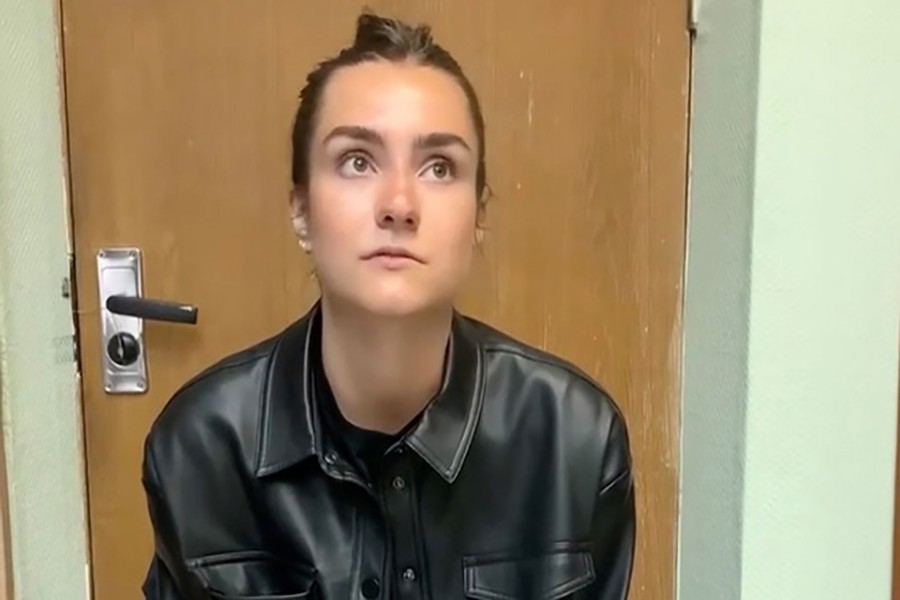 """A view shows a woman, who names herself Sofia Sapega and admits that she is the editor of a Telegram channel """"Chernaya Kniga Belarusi"""" (Black Book of Belarus) which discloses the personal information of internal affairs officers, at an unknown location, in this still image taken from video released May 25, 2021."""