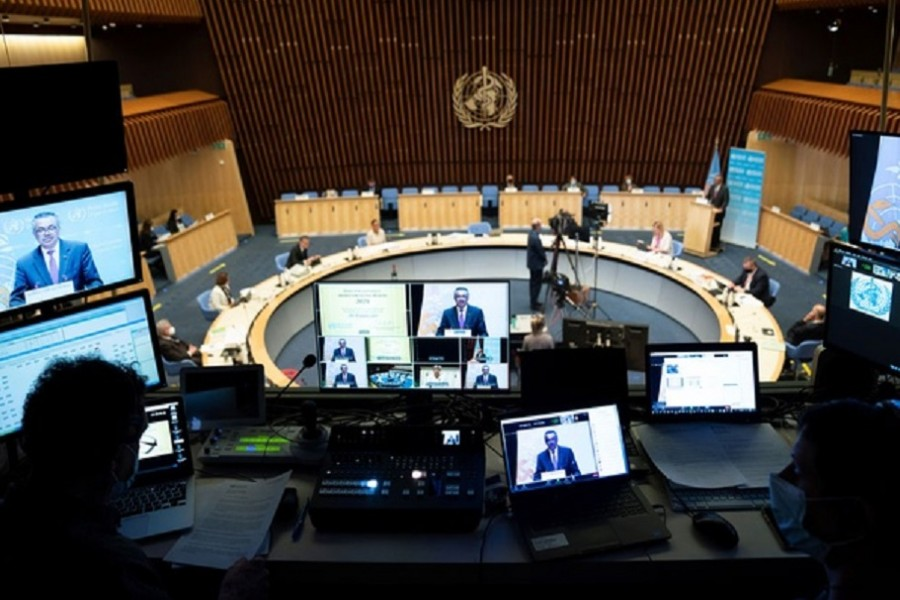 World Health Organization (WHO) Director General Tedros Adhanom Ghebreyesus is seen on screens as he attends the World Health Assembly (WHA) amid the coronavirus disease (COVID-19) pandemic in Geneva, Switzerland, May 24, 2021. Christopher Black/World Health Organization/Handout via REUTERS
