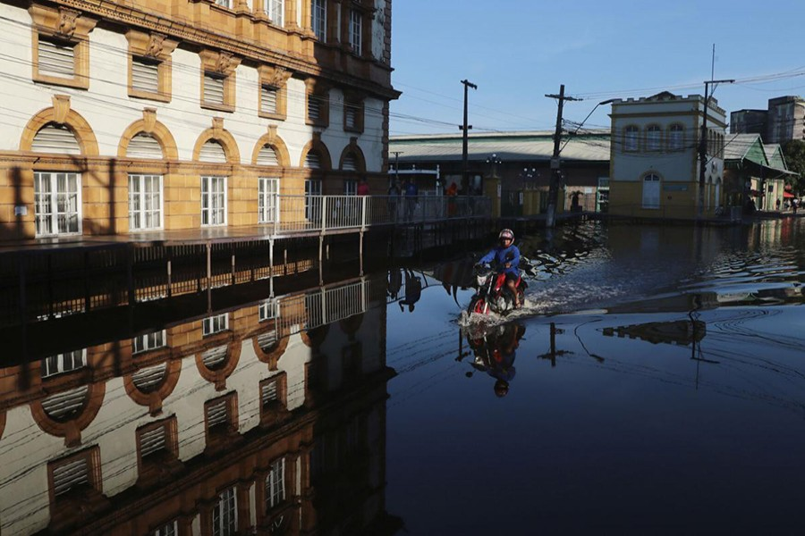In Brazil's Amazonian, rivers swell to 100-year highs