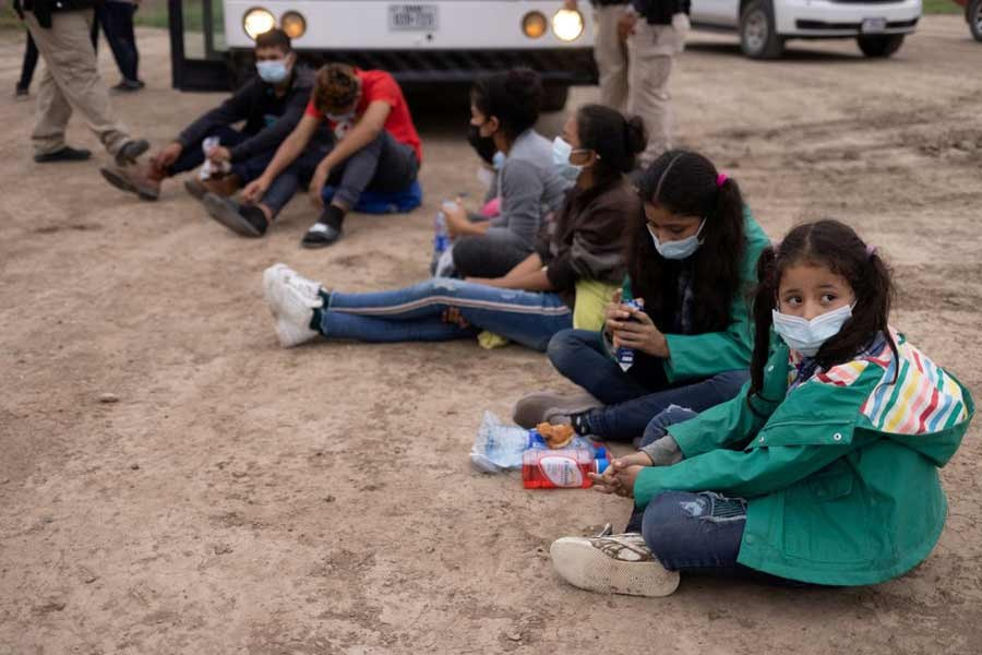 Chanel, 7, and her sister Adriana, 10, both unaccompanied minors travelling alone from Honduras, sits among other asylum-seeking children on May 6 as they wait to be transported to a US border patrol processing facility after crossing the Rio Grande river into the United States from Mexico. –Reuters file photo