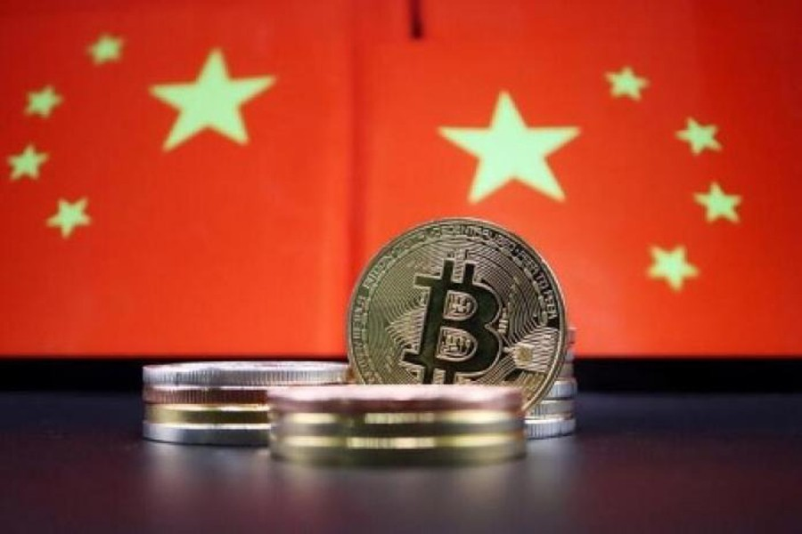 Representations of Bitcoin cryptocurrency are seen in front of an image of Chinese flags in this illustration picture taken on June 2, 2021 — Reuters/Files