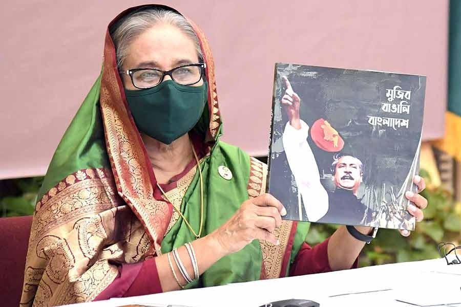 Prime Minister Sheikh Hasina unveiling the cover of a memorial publication, titled Mujib Bangalee Bangladesh, at a function on Tuesday marking 35th founding anniversary of the Special Security Force (SSF) -PID Photo
