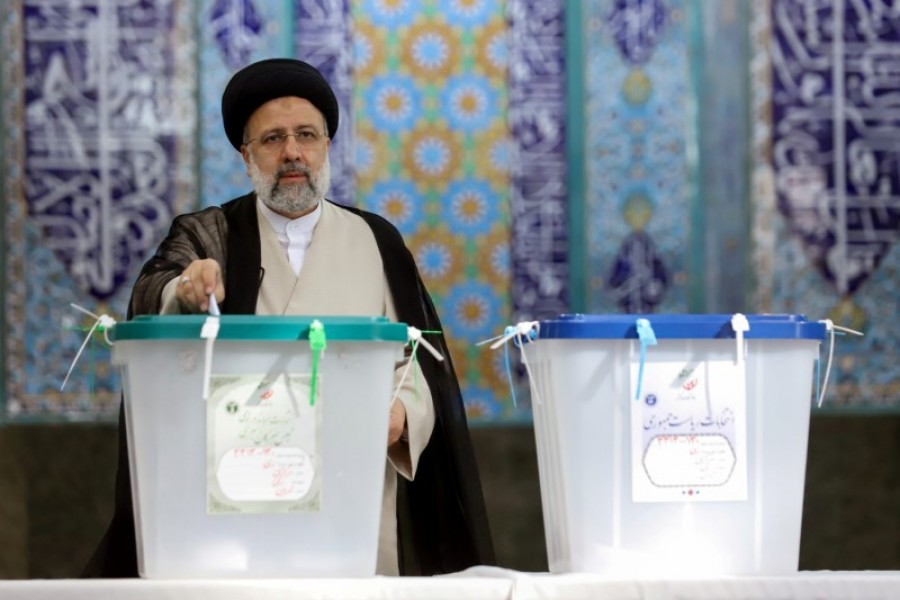 Iranian presidential candidate Ebrahim Raisi casts his vote during elections at a polling station in Tehran, Iran on June 18, 2021 — WANA via REUTERS