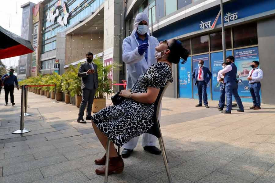 An Indian healthcare worker collecting a swab sample from a woman during a rapid antigen testing campaign for coronavirus disease (COVID-19), outside a shopping mall in Mumbai, on March 22 this year -Reuters file photo