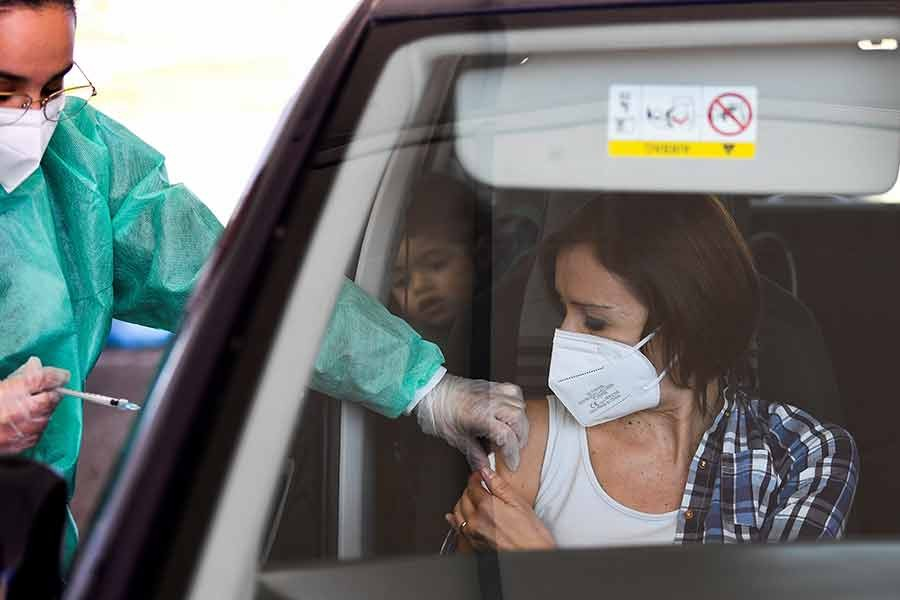 A woman receiving a shot of COVID-19 vaccine at a drive-through site in Milan of Italy on March 15 this year -Reuters file photo