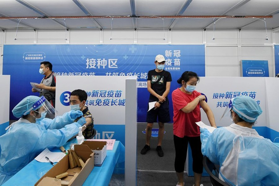 Residents receive vaccines against the coronavirus disease (Covid-19) at a makeshift vaccination site in Guangzhou, Guangdong province, China on June 21, 2021 — cnsphoto via REUTERS