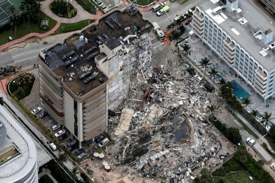 An aerial view showing a partially collapsed building in Surfside near Miami Beach, Florida, US, June 24, 2021. Reuters