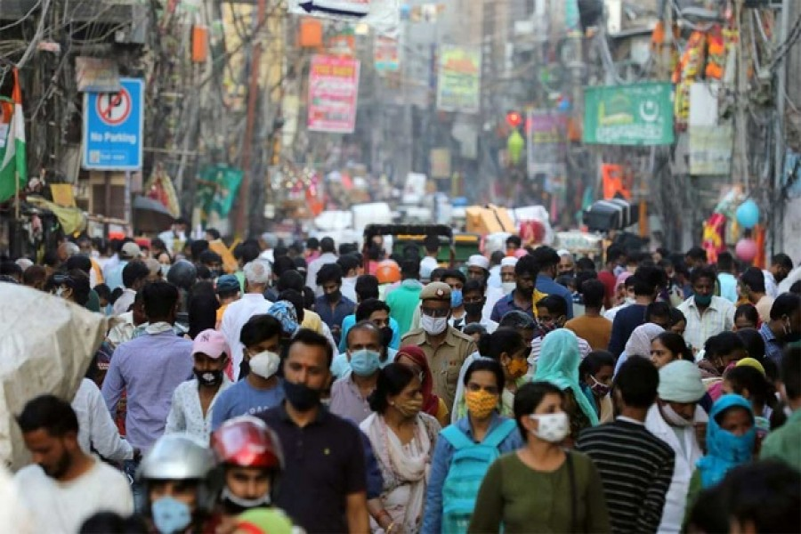 People are seen at a market amidst the spread of the coronavirus disease (COVID-19), in the old quarters of Delhi, October 19, 2020. REUTERS