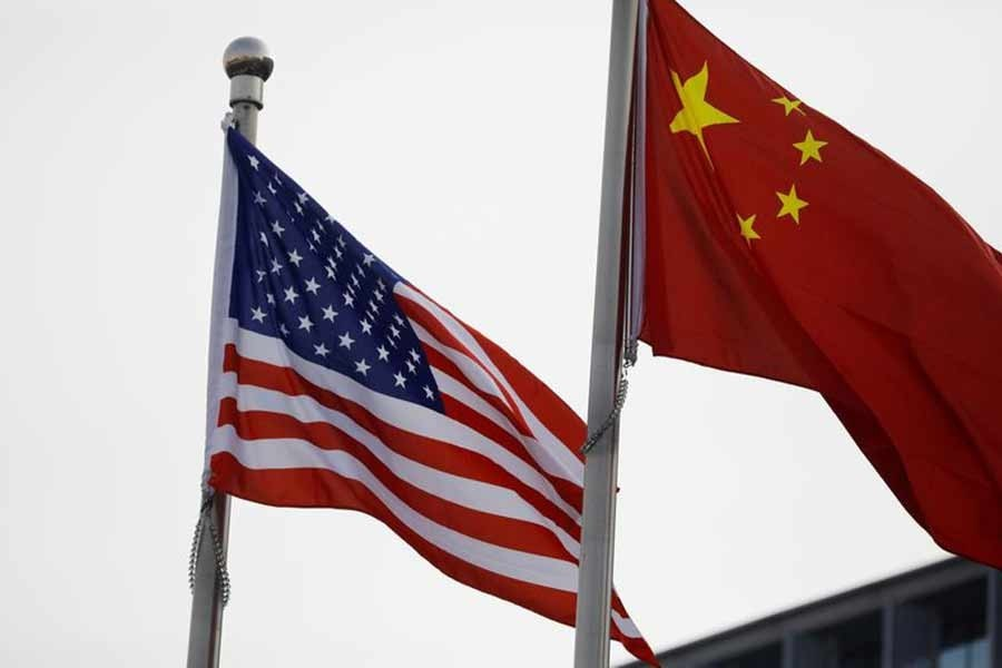 Chinese and US flags flutter outside the building of an American company in Beijing, China on January 21, 2021 — Reuters/Files