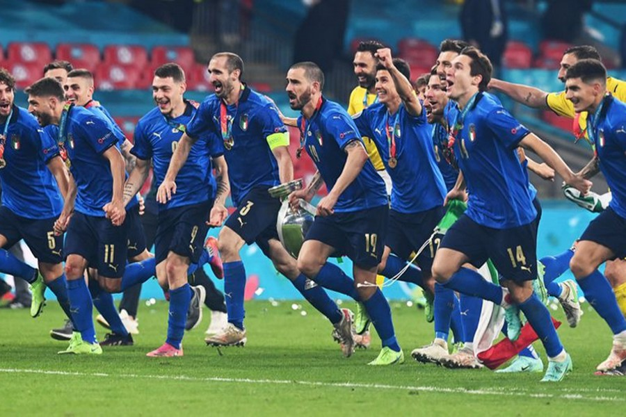 Italy celebrate with the trophy after winning Euro 2020  — Pool via Reuters