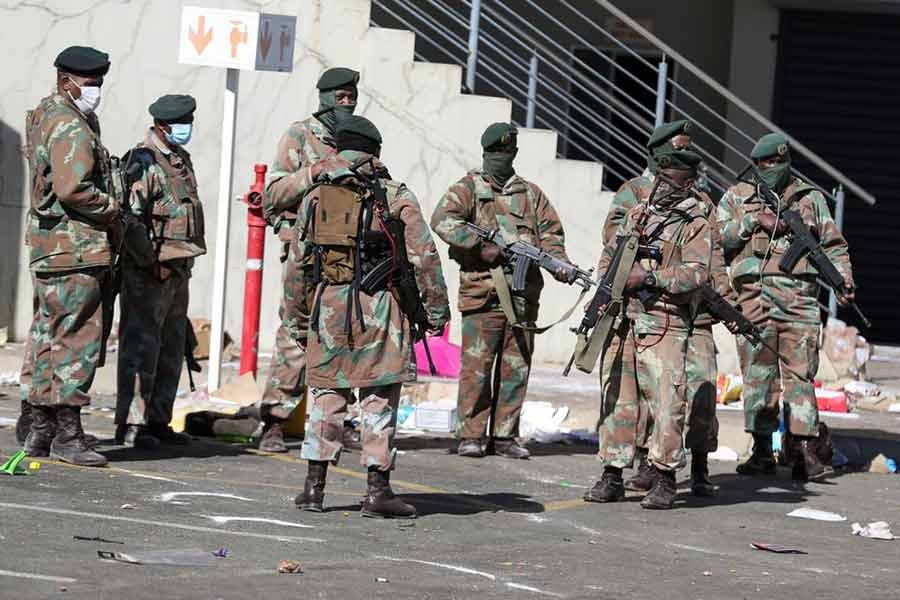 Members of the military keeping guard at a mall in South Africa on Tuesday as the country deploys army to quell unrest linked to jailing of former President Jacob Zuma -Reuters photo