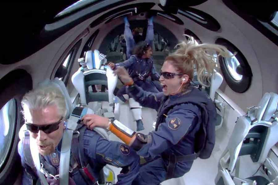 Billionaire Richard Branson makes a statement as crew members Beth Moses and Sirisha Bandla float in zero gravity on board Virgin Galactic's passenger rocket plane VSS Unity after reaching the edge of space above Spaceport America in US on July 11.  —Reuters