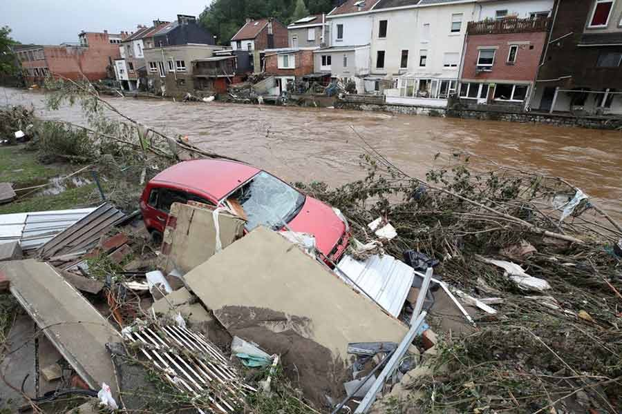 A damaged vehicle is seen next to the river on Friday in Pepinster of Belgium following heavy rainfalls -Reuters photo