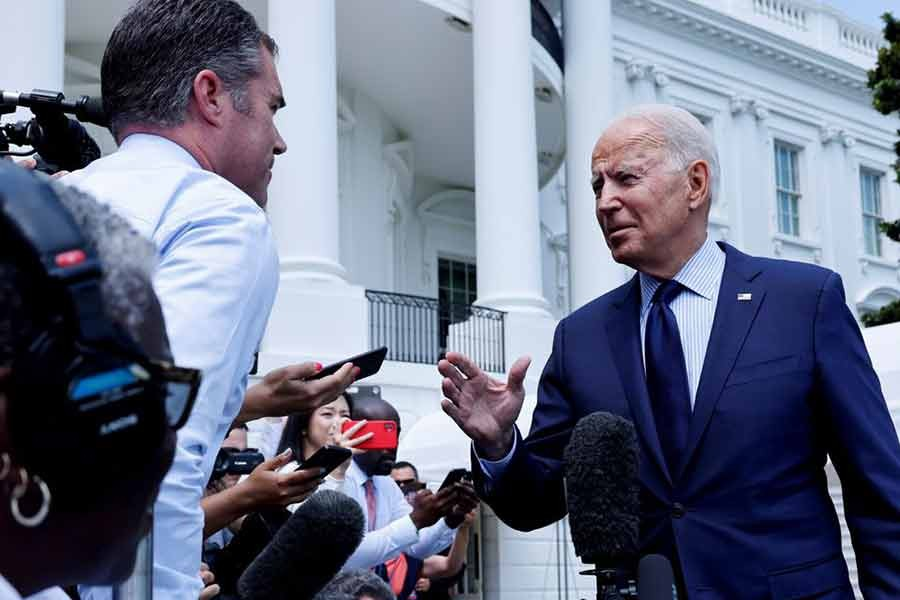 US President Joe Biden talking to the media as he departs for a weekend visit to Camp David from the White House in Washington on Friday -Reuters photo