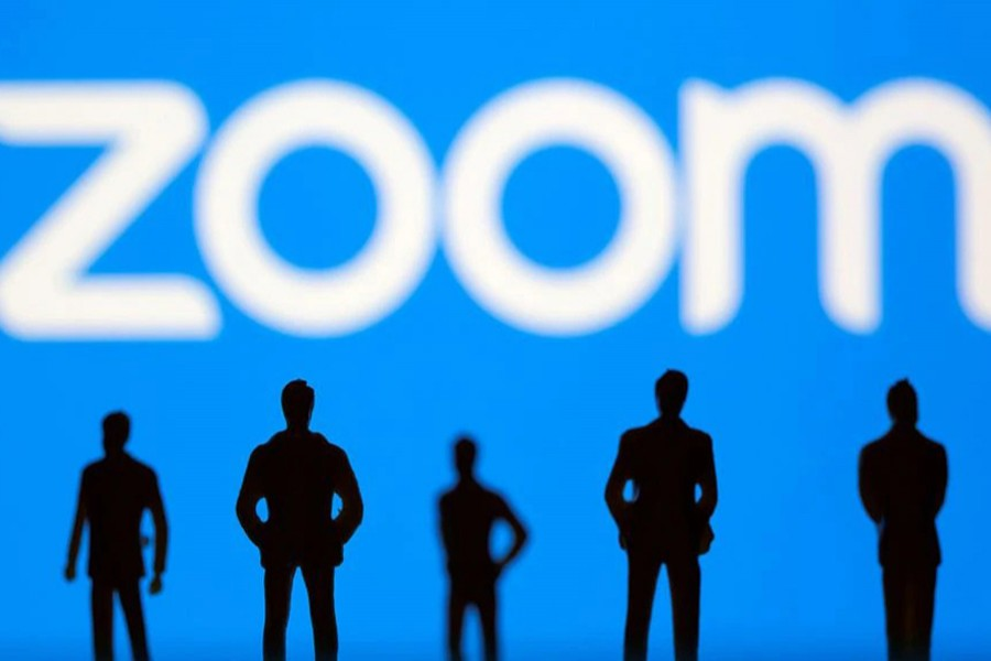 Small toy figures are seen in front of Zoom logo in this illustration picture taken on March 15, 2021 — Reuters/Files