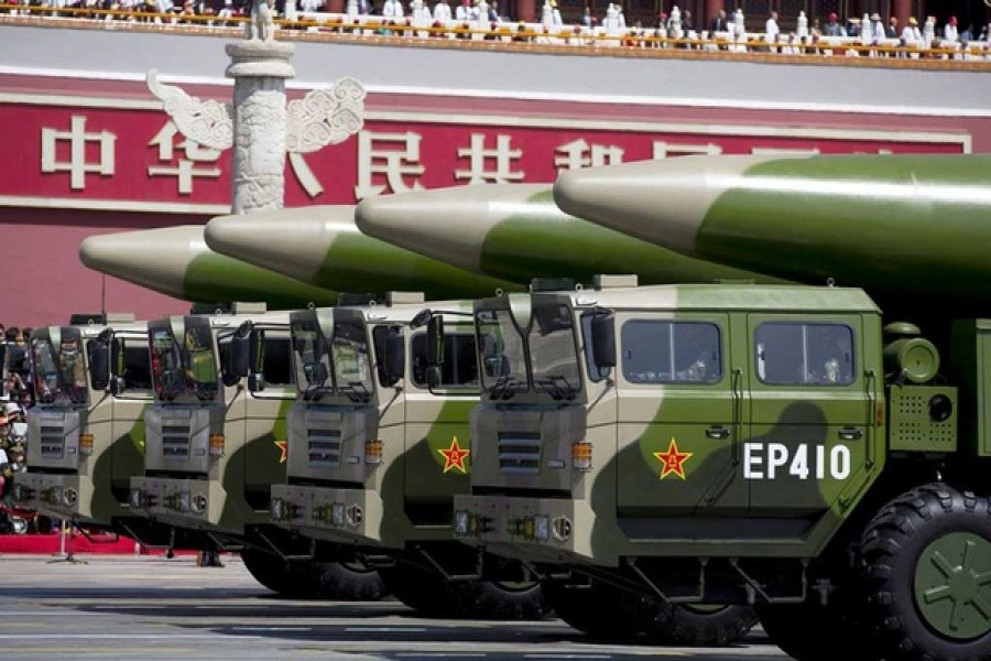 Military vehicles carrying DF-26 ballistic missiles travel past Tiananmen Gate during a military parade to commemorate the 70th anniversary of the end of World War II in Beijing, Thursday, Sept 3, 2015 — Reuters/Files