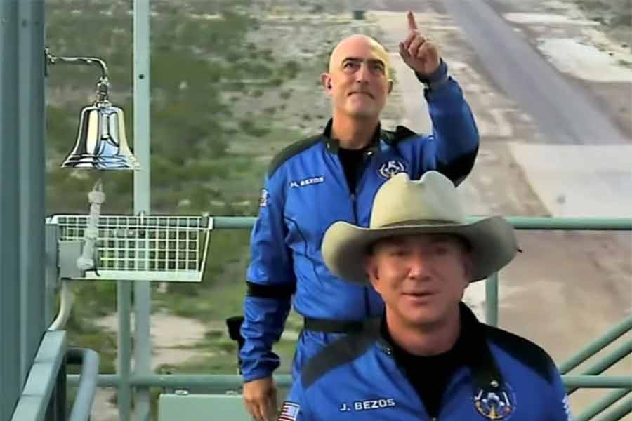 Billionaire Jeff Bezos, founder of ecommerce company Amazon.com Inc, and his brother Mark board ahead of their scheduled flight aboard Blue Origin's New Shepard rocket near Van Horn in Texas of the United States on Tuesday. The still image was captured from a video. -Reuters Photo