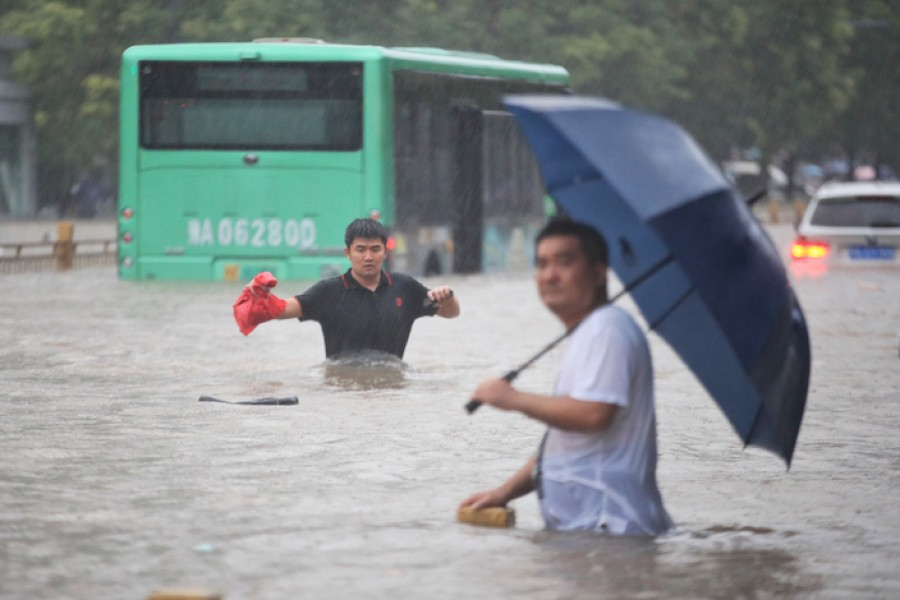 At least 12 dead as floodwaters rush into subway tunnel in China