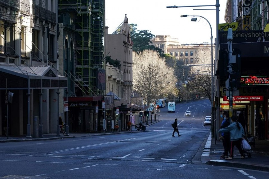A pedestrian crosses an almost empty street in the City Centre during a lockdown to curb the spread of the coronavirus disease (Covid-19) outbreak in Sydney, Australia on July 21, 2021 — Reuters photo