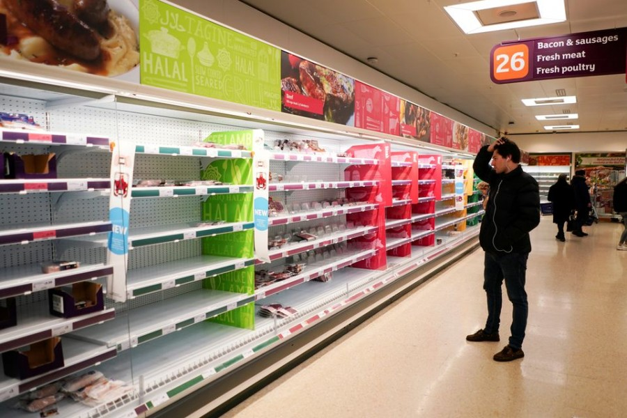 A man stands next to shelves empty of fresh meat in a supermarket, as the number of worldwide coronavirus cases continues to grow, in London, Britain, March 15, 2020. REUTERS/Henry Nicholls