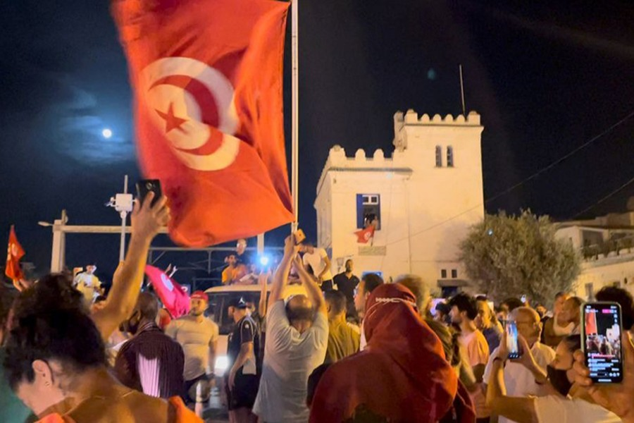 Crowds gather on the street after Tunisia's president suspended parliament, in La Marsa, near Tunis, Tunisia on July 26, 2021, in this still image obtained from a social media video — Layli Foroudi via REUTERS