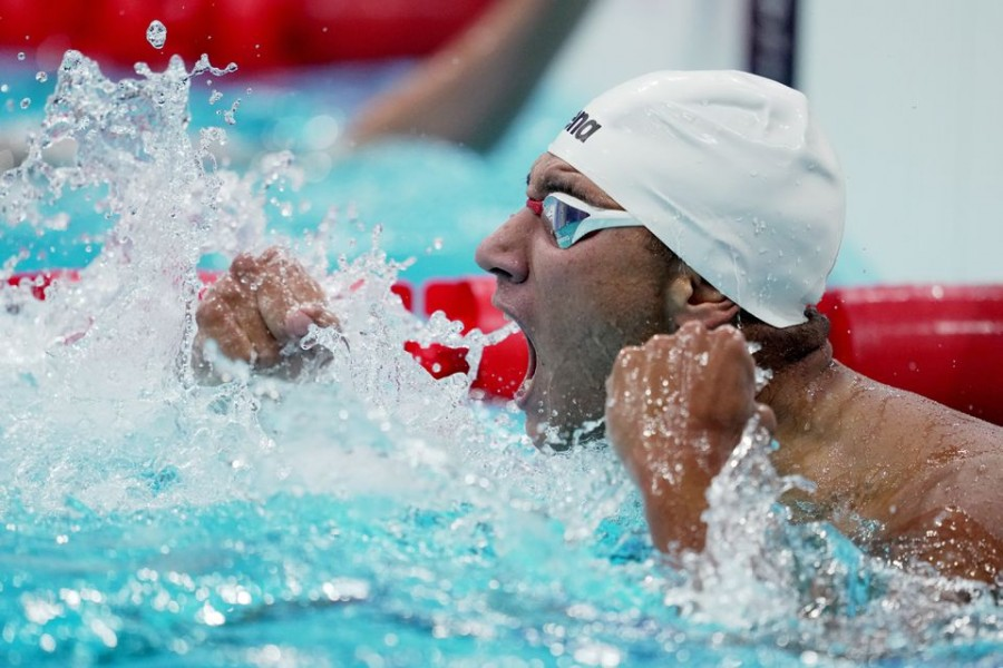 Ahmed Hafnaoui of Tunisia reacts after winning gold — Reuters photo