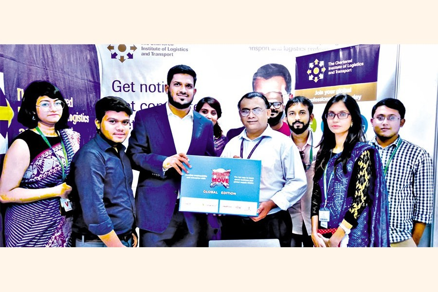 """Tanjil Ahmed Ruhullah presenting the CILT """"Business on the Move"""" board game to the students of the OSCM department of American International University Bangladesh in their job fair"""