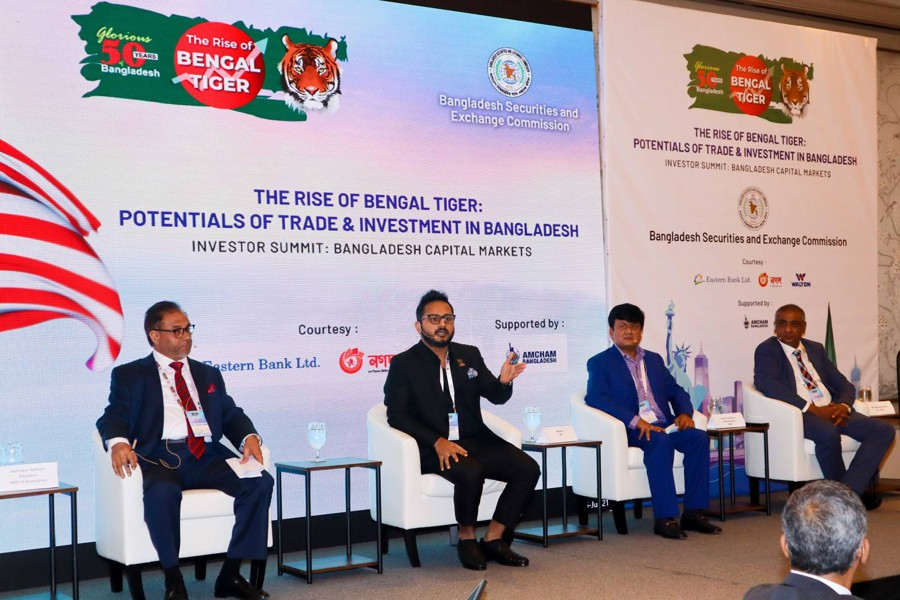 Walton Hi-Tech Industries Limited Managing Director Engineer Golam Murshed (2nd from the left) seen speaking during the first part of the roadshow organised by BSEC
