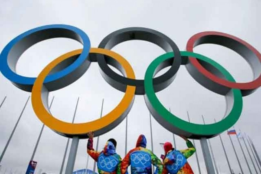 Tokyo reports record virus cases days after Olympics begin