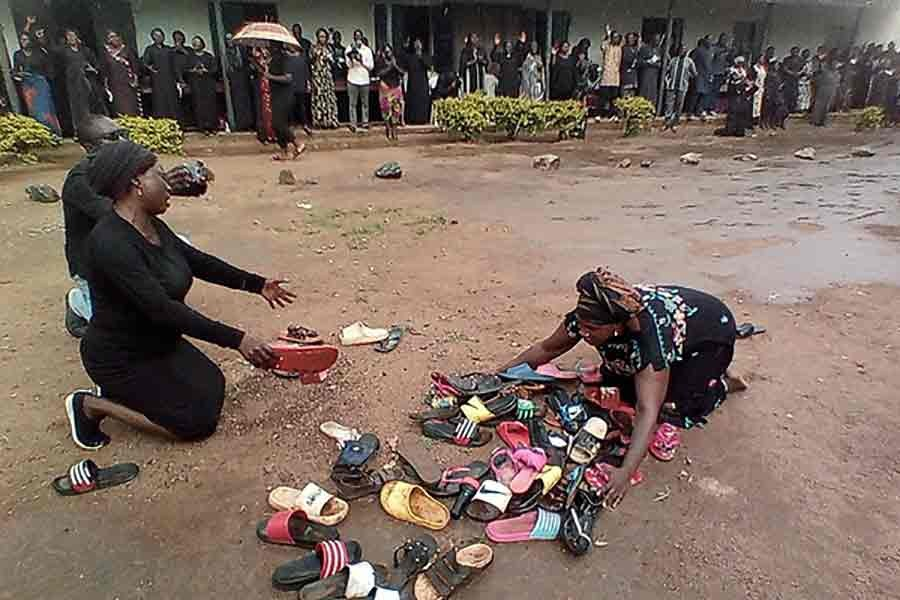 Parents of students abducted at Bethel Baptist High School pray for their safe return around discarded shoes left behind by the children in Nigeria on July 9 this year -Reuters file photo