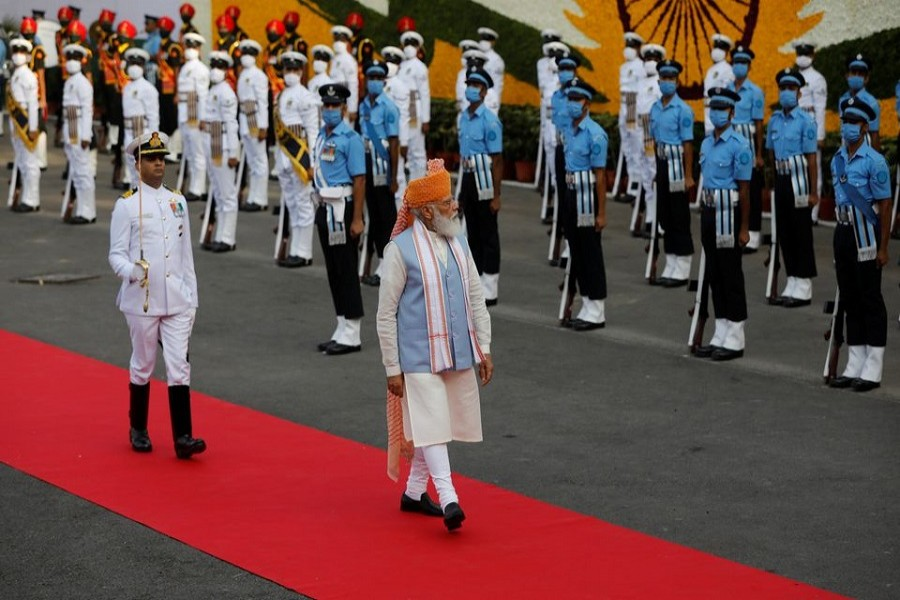 Indian Prime Minister Narendra Modi inspects the honour guard during Independence Day celebrations at the historic Red Fort in Delhi, India, August 15, 2021 — Reuters