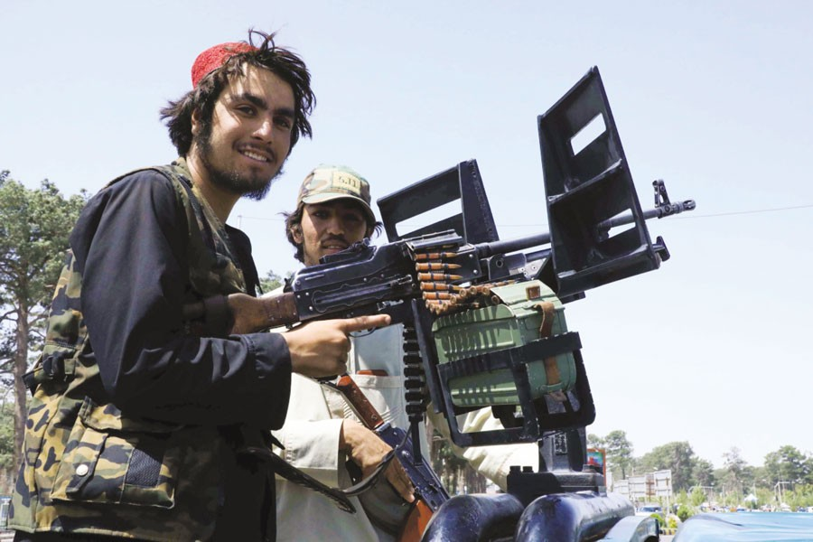 Taliban fighters patrol a street in the city of Herat. —Reuters photo