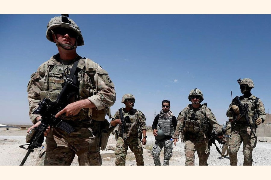 A file photo shows US troops patrol at an Afghan National Army (ANA) Base in Logar province, Afghanistan.  —Reuters photo