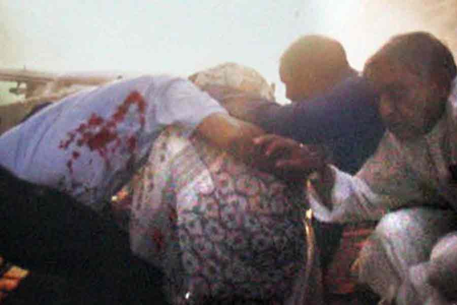 Awami League leaders and activists created a human shield risking their lives and saved the incumbent Prime Minister Sheikh Hasina from gruesome grenade attacks at Bangabandhu Avenue in the capital on August 21 in 2004. -Focus Bangla file photo