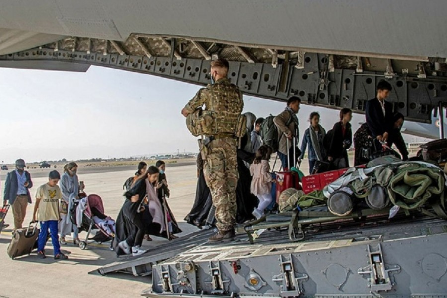British citizens and dual nationals residing in Afghanistan board a military plane for evacuation from Kabul airport, Afghanistan August 16, 2021, in this handout picture obtained by Reuters on August 17, 2021. LPhot Ben Shread/UK MOD Crown copyright 2021/Handout via REUTERS