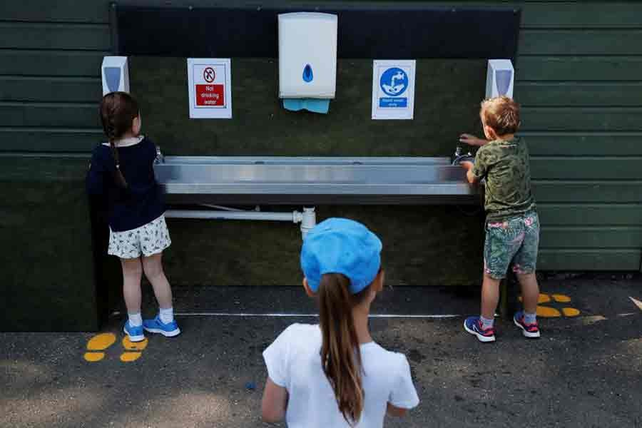 Children washing their hands at Heath Mount School at Watton-at-Stone in Britain as some schools reopen following the outbreak of the COVID-19 last year -Reuters file photo