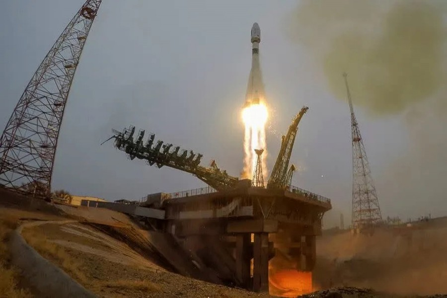 A rocket with 38 satellites blasts off from a launchpad at the Baikonur Cosmodrom
