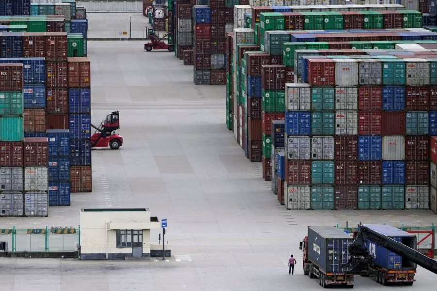 Containers are seen at the Yangshan Deep-Water Port in Shanghai, China October 19, 2020. REUTERS/Aly Song
