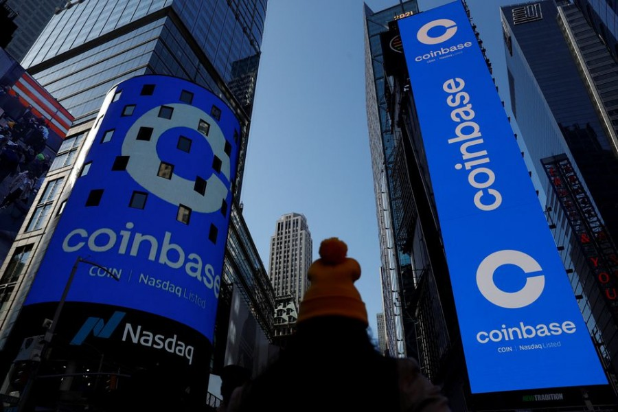 The logo for Coinbase Global Inc, the biggest US cryptocurrency exchange, is displayed on the Nasdaq MarketSite jumbotron and others at Times Square in New York, US, April 14, 2021. REUTERS/Shannon Stapleton/File Photo