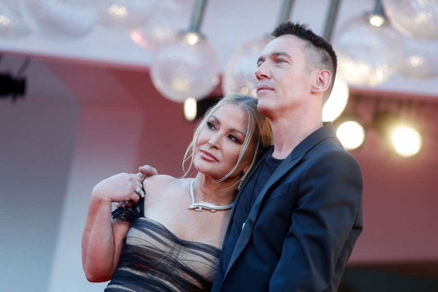 """The 78th Venice Film Festival - Premiere screening of the film """"Freaks out"""" in competition - Red Carpet Arrivals - Venice, Italy September 8, 2021 - Singer Anastacia and actor Jonathan Rhys Meyers pose. REUTERS/Yara Nardi"""